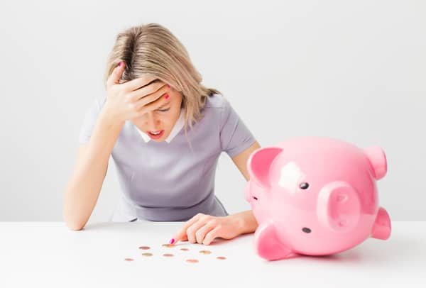 woman with empty piggy bank preparing for an emergency budget