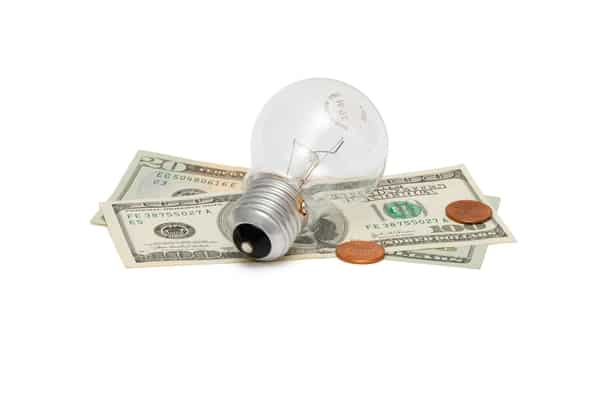 light bulb over money to depict saving money on utilities for an emergency budget